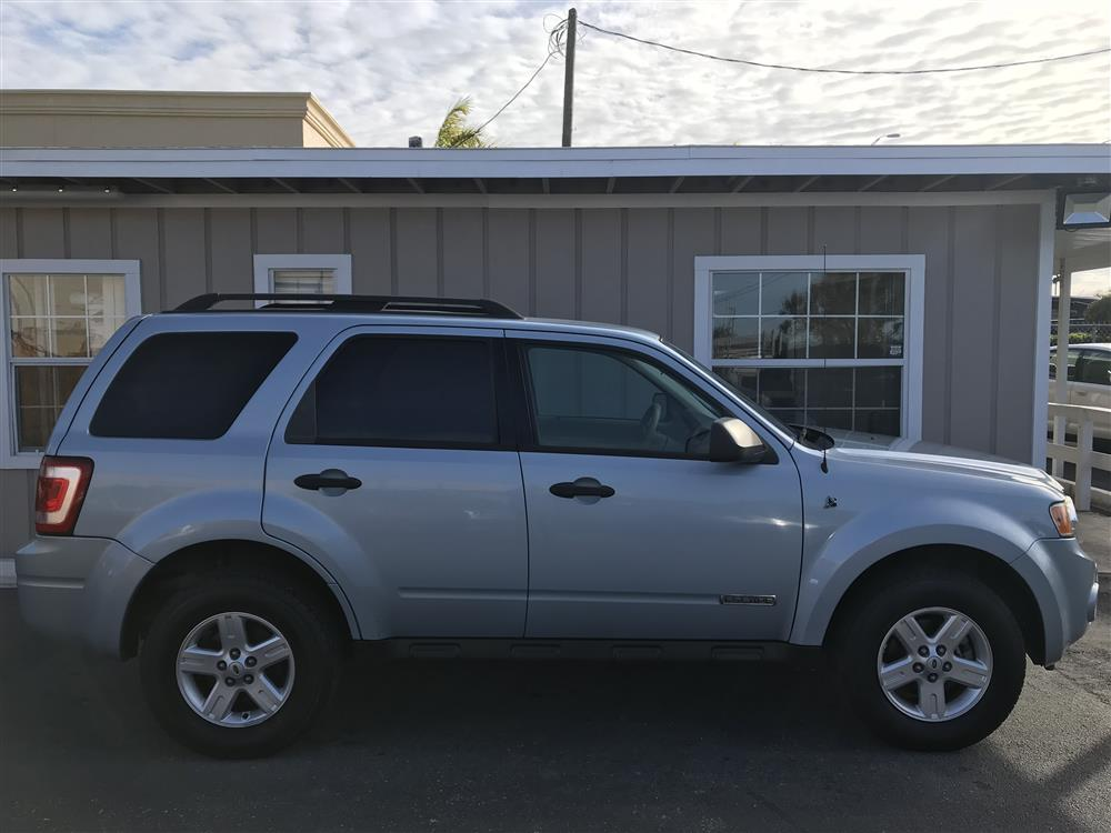 2008 Ford Escape Hybrid. Great on gas!